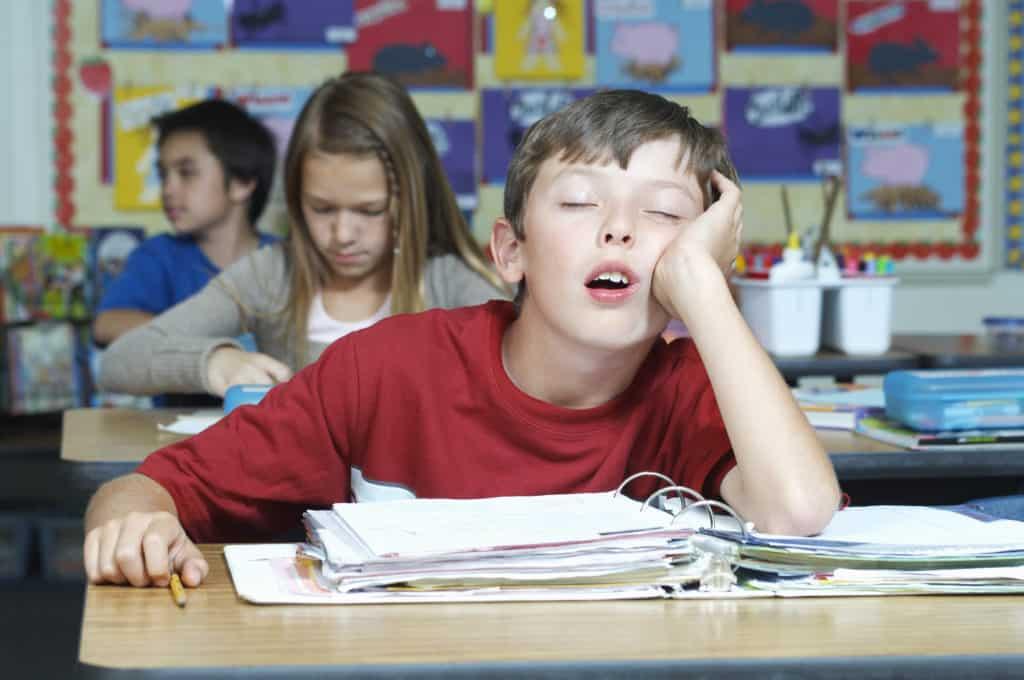 wellness ortho child sleeping in class