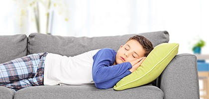 wellness orthodontics child sleeping on couch