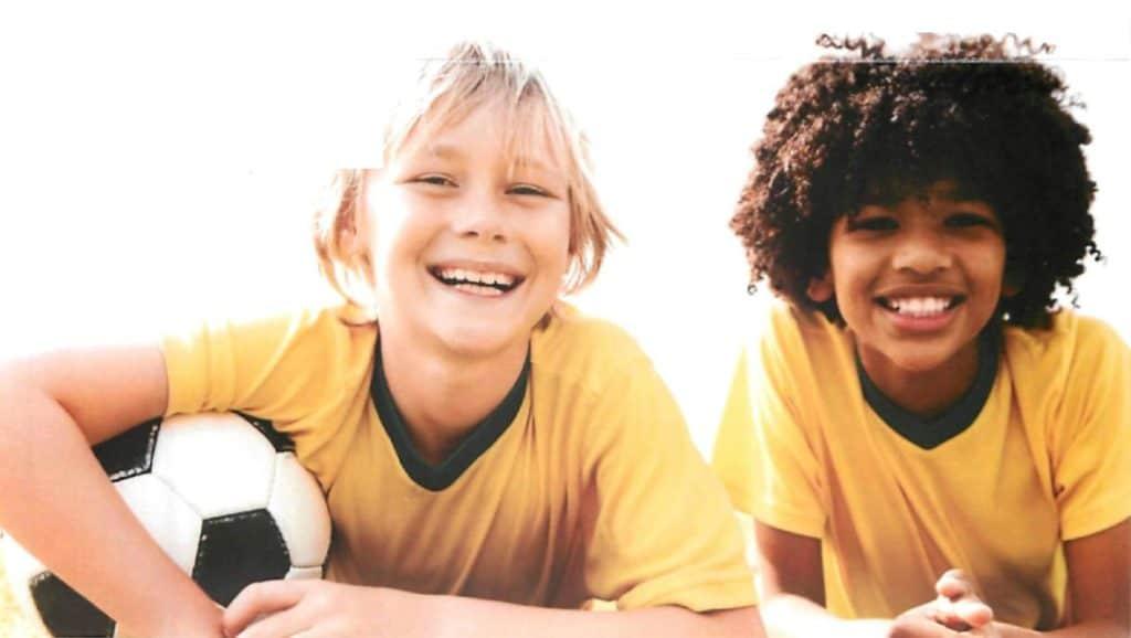 wellness orthodontics happy boys with soccer ball